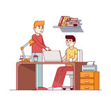 Two man working on homework project in dorm room. Two young man working on university homework project together in dorm room or office. Teen boy student sitting Royalty Free Stock Photos