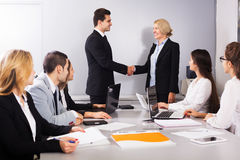 Two managers handshaking Royalty Free Stock Images
