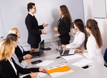 Two managers handshaking Royalty Free Stock Image