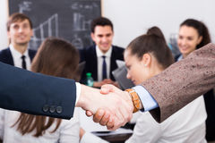 Two managers shaking hands Royalty Free Stock Photo