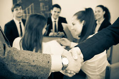Two managers shaking hands Royalty Free Stock Photos
