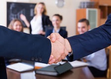 Two managers shaking hands indoors Royalty Free Stock Images