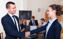 Two managers shaking hands and smiling Stock Images