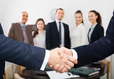 Two managers shaking hands Stock Photography
