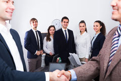 Two managers shaking hands Royalty Free Stock Image