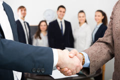 Two managers shaking hands Stock Photo