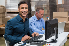 Two managers working on laptop at desk Royalty Free Stock Photo