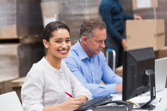 Two managers working on laptop at desk Royalty Free Stock Photography