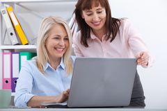 Two managers working on laptop in office. royalty free stock photo