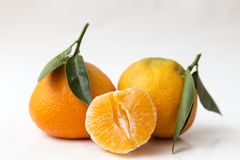 Two mandarins and half peeled Stock Photo