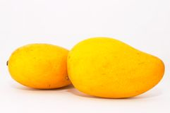 Two mango on side. Two Mangos on plain background Stock Photography