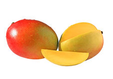 Two mangoes. And slice isolated on white background Stock Photos