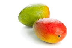 Two mangoes over white background Royalty Free Stock Photo