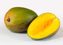 Two mangoes on white background Stock Photos