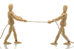 Two manikins pulling a rope Stock Photography