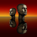 Two manneqiun heads on a dark reflective surface Stock Image