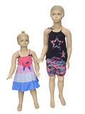 Two mannequins dressed in summer fashion for children. Royalty Free Stock Photos