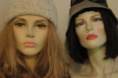 Two mannequins faces. Faces of two damaged female mannequins stock photo