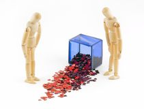 Two Mannequins Look at Spilled Box of Hearts Royalty Free Stock Photos