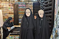 Two mannequins wearing in  black chadors, Tehran Grand Bazaar, I. Tehran, Iran - April 29, 2017: Two mannequins dressed in black Islamic clothes, a religious Royalty Free Stock Photos