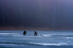 Fishing on the frozen lake Stock Photo