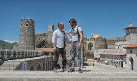 Two mans model with sunglasses and white shirt in old Georgian castle stock image