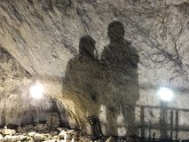 Free Two Mans Shadows On A Wall In Ialominta Cave Stock Images - 113354504