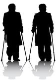 Two mans whit crutches Royalty Free Stock Image
