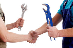 Two manual workers shaking their hands Royalty Free Stock Photo