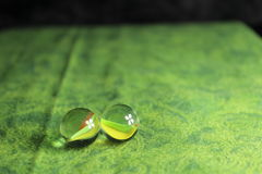 Two Marbles on Green Background Royalty Free Stock Photography