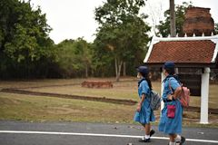 Two marching girl scouts in Sukhothai Historical Park royalty free stock image