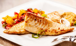 Two marinated grilled fresh tilapia fillets Royalty Free Stock Images