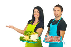 Two market workers making presentation Royalty Free Stock Images