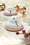 Two marshmallow snowmen biscuits Royalty Free Stock Photos