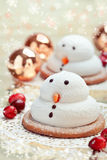 Two marshmallow snowmen biscuits Royalty Free Stock Photo