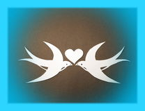 Two martin birds and heart. Paper cutting stock photo