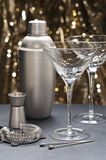 Two Martini glasses with bartender tools Stock Photos
