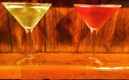 Two martini glasses full green and red. Martini glasses red green fill bar pub drinking Stock Photo