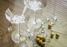 Two martini glasses with olives on martini picks Stock Photos