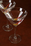 Two martinis. Two gin martinis on a mahogany bar top Royalty Free Stock Photography