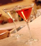 Two Martinis. Two vodka martinis setting on a bar Royalty Free Stock Photos