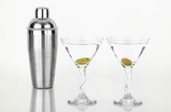 Two martinis with stainless steel shaker. On a reflective surface Stock Photo
