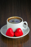 Two marzipan hearts and coffee cup Stock Photography