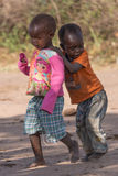 Two Masai boys in western dress playing Royalty Free Stock Image