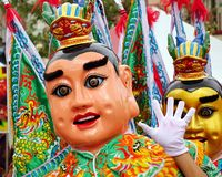 Two Masked Dancers at a Temple Carnival in Taiwan Royalty Free Stock Image