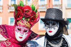 Two masked persons at Carnival of Venice Stock Photos
