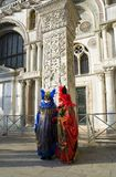 Two masks with pillar. Two carnival masks, great event in Venice Stock Photo