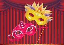 Two masks on red curtain background Stock Photography