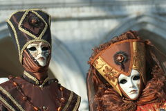 Two masks in Venice Carnival. During the Carnival, hundreds of people wearing wonderful colourful costumes and masks come to Venice from all over the world stock image