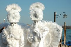 Two masks -white angels at Venice carnival Stock Photos